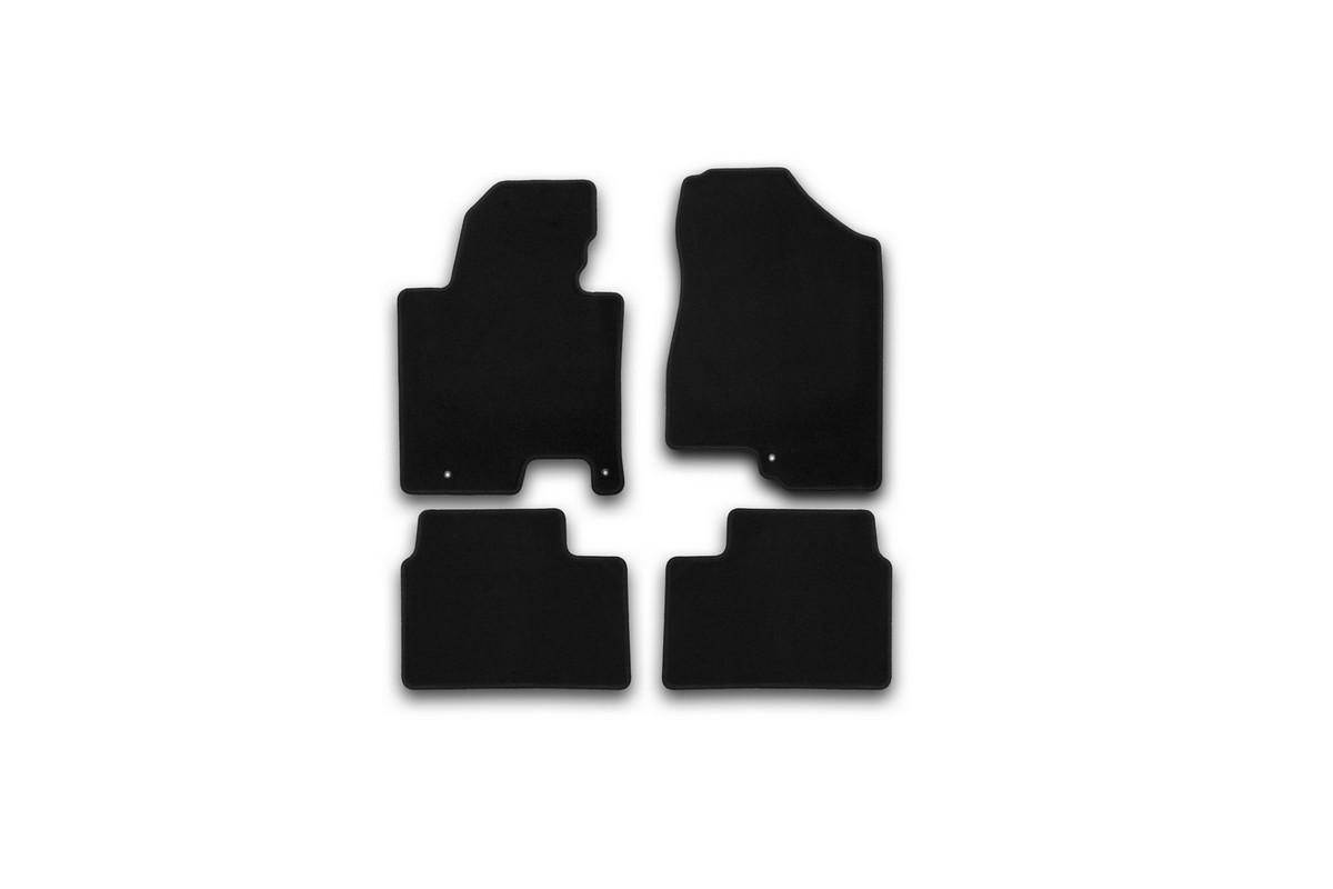 Набор автомобильных ковриков Klever для Kia Ceed АКПП 2012-, хэтчбек/универсал, в салон, 4 штKVR01254501200kНабор автомобильных ковриков Klever, изготовленный из текстиля, состоит из 4 ковриков, которые учитывают все особенности каждой модели автомобиля и полностью повторяют контуры пола. Текстильные автомобильные коврики для салона произведены из высококачественного материала, который держит форму, прочный и не пачкает обувь. Коврики в салон не только улучшат внешний вид салона вашего автомобиля, но и надежно уберегут его от пыли, грязи и сырости, а значит, защитят кузов от коррозии. Текстильные коврики для автомобиля мягкие и приятные, а их основа из вспененного полиуретана не пропускает влагу. Ковры для автомобилей надежно крепятся на полу и не скользят, что очень важно во время движения. Чистятся коврики очень просто: как при помощи автомобильного пылесоса, так и различными моющими средствами. Набор подходит для Kia Ceed АКПП хэтчбек/универсал с 2012 года выпуска.