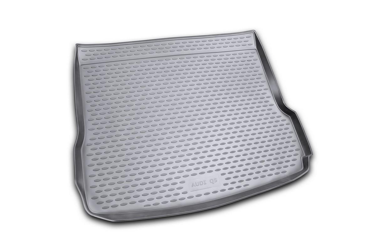 Коврик автомобильный Novline-Autofamily для Audi Q5 кроссовер 01/2009-, в багажник. NLC.04.15.B12NLC.04.15.B12Автомобильный коврик Novline-Autofamily, изготовленный из полиуретана, позволит вам без особых усилий содержать в чистоте багажный отсек вашего авто и при этом перевозить в нем абсолютно любые грузы. Этот модельный коврик идеально подойдет по размерам багажнику вашего автомобиля. Такой автомобильный коврик гарантированно защитит багажник от грязи, мусора и пыли, которые постоянно скапливаются в этом отсеке. А кроме того, поддон не пропускает влагу. Все это надолго убережет важную часть кузова от износа. Коврик в багажнике сильно упростит для вас уборку. Согласитесь, гораздо проще достать и почистить один коврик, нежели весь багажный отсек. Тем более, что поддон достаточно просто вынимается и вставляется обратно. Мыть коврик для багажника из полиуретана можно любыми чистящими средствами или просто водой. При этом много времени у вас уборка не отнимет, ведь полиуретан устойчив к загрязнениям.Если вам приходится перевозить в багажнике тяжелые грузы, за сохранность коврика можете не беспокоиться. Он сделан из прочного материала, который не деформируется при механических нагрузках и устойчив даже к экстремальным температурам. А кроме того, коврик для багажника надежно фиксируется и не сдвигается во время поездки, что является дополнительной гарантией сохранности вашего багажа.Коврик имеет форму и размеры, соответствующие модели данного автомобиля.