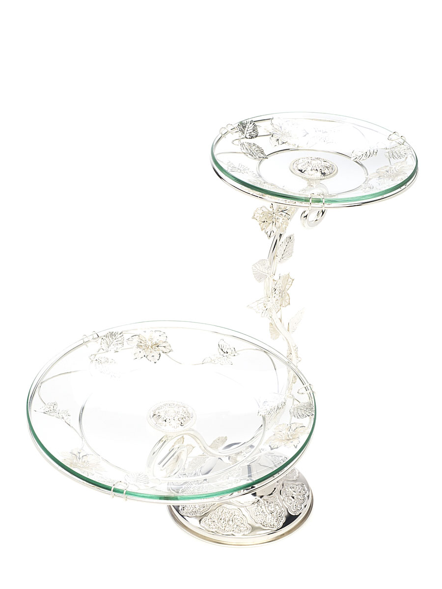 """Элегантная двухъярусная ваза """"Marquis"""", выполненная из высококачественного стекла и стали с серебряно-никелевым покрытием, предназначена для красивой сервировки фруктов и конфет. Изделие украшено оригинальным рельефом и стальными цветами и листьями. Легко собирается и разбирается. Ваза """"Marquis"""" украсит сервировку вашего стола и подчеркнет прекрасный вкус хозяина, а также станет отличным подарком. Диаметр большого блюда: 24,5 см. Диаметр малого блюда: 17,5 см.  Высота вазы: 36 см."""