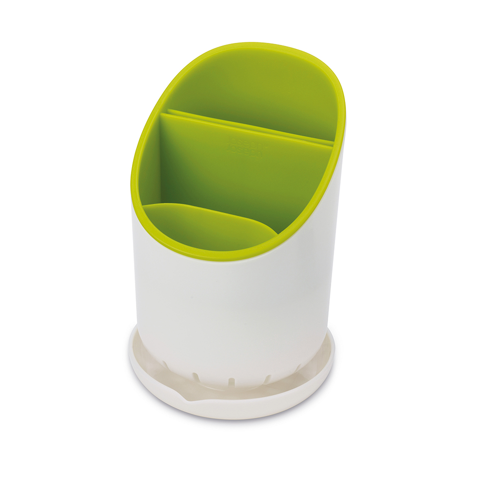 Сушилка для столовых приборов Joseph Joseph Dock, со сливом, цвет: зеленый. 8507485074Сушилка для столовых приборов Joseph Joseph Dock - это не просто сушилка для приборов, а умная сушилка. Обычно их сложно мыть, а также в них не предусмотрено разделение приборов и острых ножей. В сушилке Dock все эти недостатки исправлены.Для ножей есть специальное отделение, где острые лезвия высыхают безопасно и не соприкасаются с другими приборами. Излишек воды собирается в поддон, и её можно слить безо всяких проблем. Сушилка удобно разбирается для чистки. И к тому же она будет очень стильно смотреться на любой кухне.