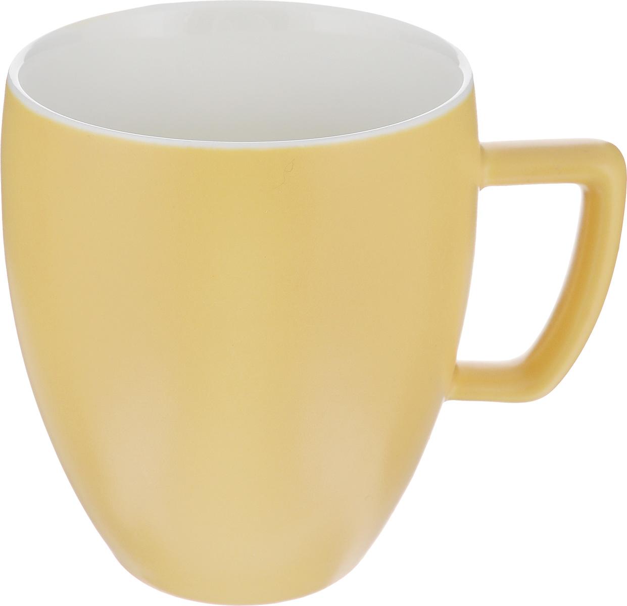 Кружка Tescoma Crema Tone, цвет: желтый, 300 мл387146_желтыйКружка Tescoma Crema Tone, изготовленная из высококачественного фарфора, прекрасно дополнит интерьер вашей кухни. Изящный дизайн кружки придется по вкусу и ценителям классики, и тем, кто предпочитает утонченность и изысканность. Кружка Tescoma Crema Tone станет хорошим подарком к любому празднику. Диаметр (по верхнему краю): 8 см.Высота: 10 см.