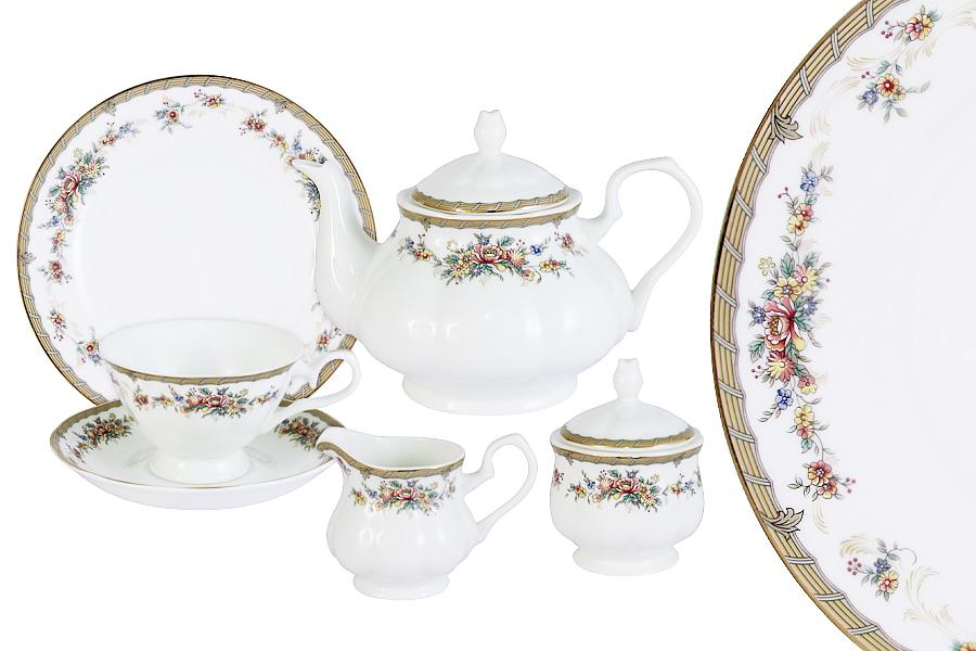 Чайный сервиз Emerald Изабелла, 21 предметE5-15-606/21-ALЧайный сервиз Emerald состоит из 6 чашек, 6 блюдец, 6 десертных тарелок, чайника, сахарницы и молочника. Изделия изготовлены из высококачественного костяного фарфора с изящным орнаментом. Поверхность изделий покрыта превосходной сверкающей глазурью, не содержащей свинца.Благодаря высокому качеству исполнения, разнообразным декорам и оптимальному соотношению цена/качество, посуда Emerald завоевала огромную популярность у покупателей и пользуется неизменно высоким спросом. Такой сервиз придется по вкусу любителям классики, и тем, кто предпочитает утонченность и изысканность. Объем чайника: 900 мл. Объем сахарницы: 350 мл. Объем молочника: 300 мл.