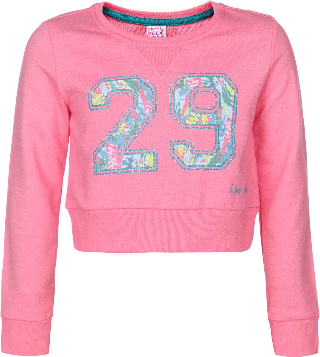 Свитшот для девочки Sela, цвет: розовый. St-613/061B-6121. Размер 116, 6 летSt-613/061B-6121Стильный свитшот для девочки Sela идеально подойдет вашей маленькой моднице в прохладные дни. Изготовленный из хлопка и полиэстера, он необычайно мягкий и приятный на ощупь, не сковывает движения и позволяет коже дышать, не раздражает даже самую нежную и чувствительную кожу ребенка, обеспечивая ему наибольший комфорт. Укороченный свитшот с длинными рукавами и круглым вырезом горловины спереди оформлен крупной термоаппликацией в виде числа 29 с блестящим напылением. Рукава имеют широкие трикотажные манжеты, не стягивающие запястья. Понизу проходит широкая трикотажная резинка. Вырез горловины также дополнен трикотажной эластичной резинкой. Современный дизайн и расцветка делают этот свитшот модным и стильным предметом детского гардероба. В нем ваша дочурка будет чувствовать себя уютно и комфортно, и всегда будет в центре внимания!