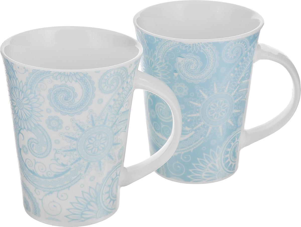 Набор кружек Elan Gallery Цветы и завитушки, цвет: белый, голубой, 320 мл, 2 шт250086Набор Elan Gallery Цветы и завитушки состоит из двух кружек, выполненных из керамики.Этот необычный набор станет великолепным подарком для каждого и, несомненно, вызоветвосхищение. Объем кружек: 320 мл. Диаметр кружек (по верхнему краю): 8,5 см. Высота кружек: 11 см.Не рекомендуется применять абразивные моющие средства. Не использовать в микроволновойпечи.