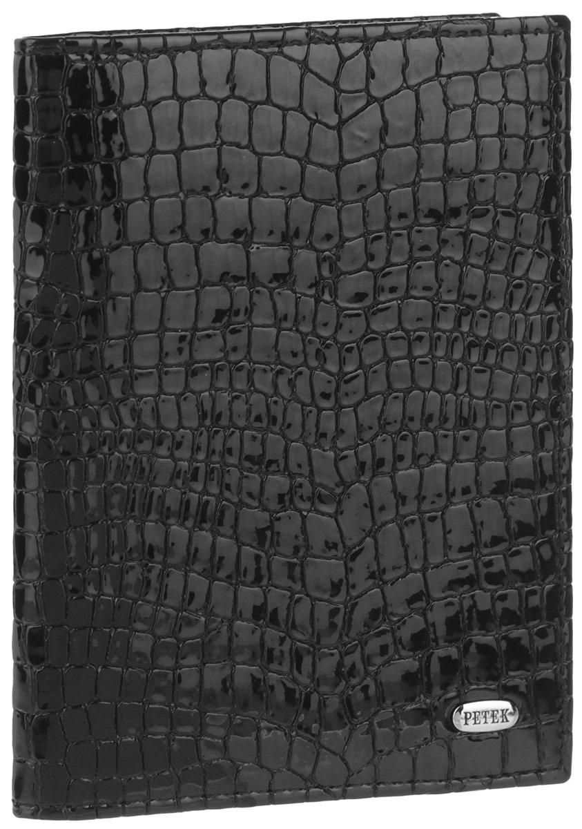 Обложка для автодокументов Petek 1855, цвет: черный. 584.091.01Натуральная кожаСтильная обложка для автодокументов Petek 1855 выполнена из натуральной лакированной кожи с тиснением под крокодила. Изделие оформлено металлической пластиной с гравировкой бренда. Внутри имеется два боковых кармана, блок из шести прозрачных файлов из мягкого пластика, один из которых формата А5 и четыре прорезных кармана для визиток и пластиковых карт.Такая обложка не только поможет сохранить внешний вид ваших документов и защитит их от повреждений, но и станет стильным аксессуаром, идеально подходящим вашему образу.
