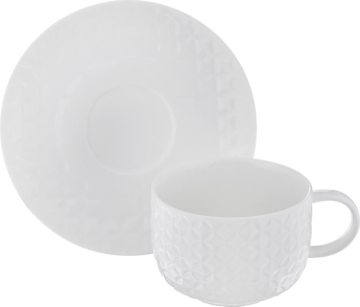 """Чайная пара Walmer """"Quincy"""" состоит из чашки и блюдца, изготовленных из фарфора белого цвета. Внешние стенки чашки декорированы объемным изображением орнамента. Чайная пара Walmer """"Quincy"""" украсит ваш кухонный стол, а также станет замечательным подарком к любому празднику. Объем чашки: 250 мл. Диаметр чашки (по верхнему краю): 9,2 см. Диаметр основания: 5 см. Высота чашки: 6,5 см. Диаметр блюдца (по верхнему краю): 15,5 см."""