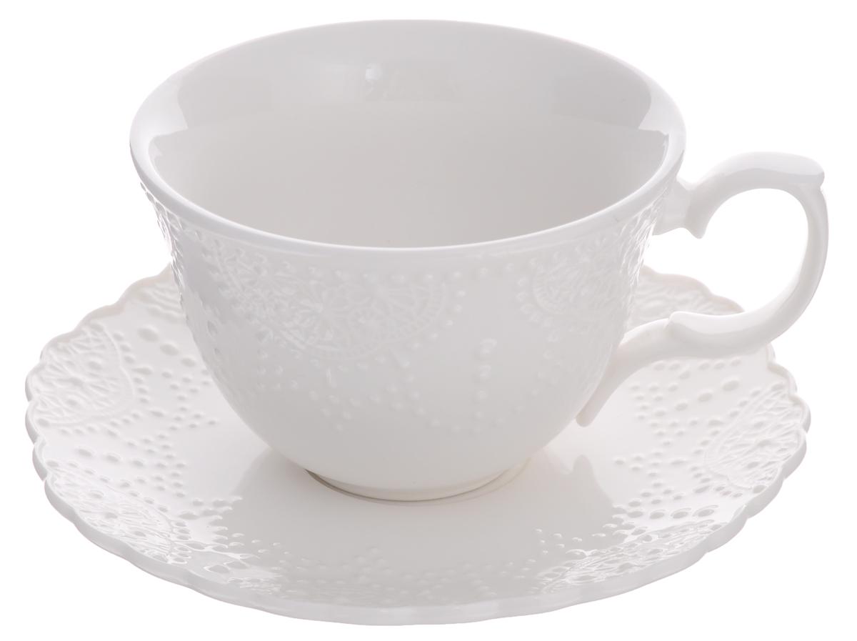 Чайная пара Walmer Vivien, цвет: белый, 2 предметаW07270025Чайная пара Walmer Vivien состоит из чашки и блюдца, изготовленных из высококачественного фарфора и оформленных рельефным рисунком. Яркий дизайн, несомненно, придется вам по вкусу.Чайная пара Walmer Vivien украсит ваш кухонный стол, а также станет замечательным подарком к любому празднику.Объем чашки: 250 мл.Диаметр чашки (по верхнему краю): 10 см.Высота чашки: 7 см.Диаметр блюдца: 15 см.