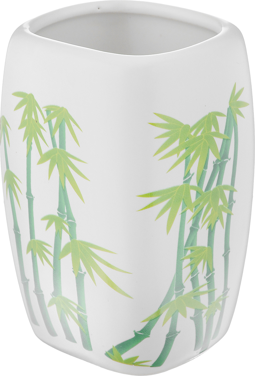 """Стакан для ванной комнаты Vanstore """"Green Bamboo"""" изготовлен из высококачественной керамики. В стакане удобно хранить зубные щетки, пасту и другие принадлежности. Такой аксессуар для ванной комнаты стильно украсят интерьер и добавят в обычную обстановку яркие и модные акценты.Размер стакана: 6,5 х 6 х 11 см."""