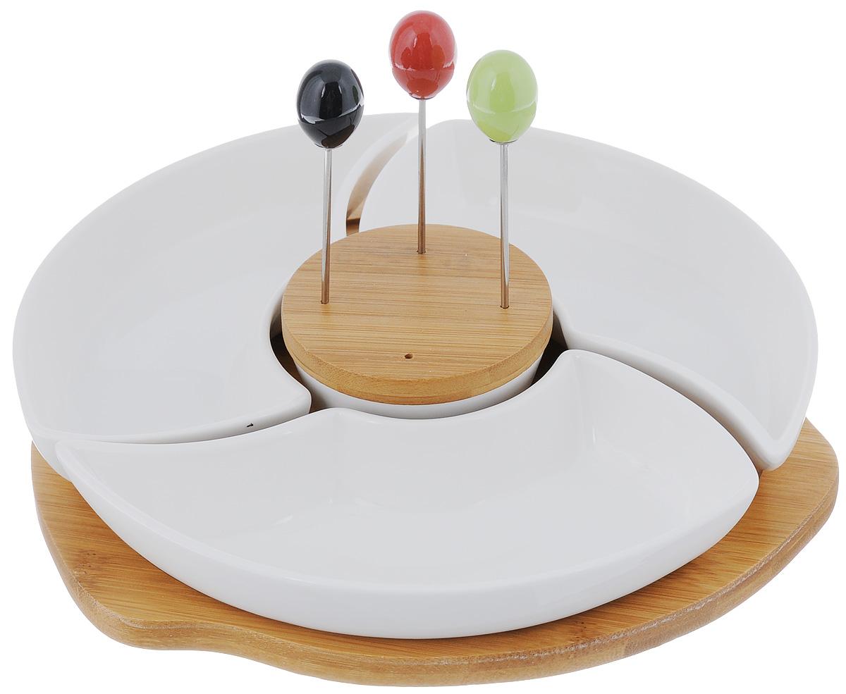 Менажница Elan Gallery Айсберг, со шпажками, на подставке, 4 секции540056Менажница Elan Gallery Айсберг, изготовленнаяиз высококачественной керамики, установленана вращающуюся подставку из дерева ипластика. Менажница состоит их 4съемных секций и предназначена для подачисразу нескольких видов закусок, нарезок илисоусов. В комплект также входят триразноцветные шпажки, которые вставляются вдеревянную подставку. Менажница Elan Gallery Айсберг станетнастоящим украшением праздничного стола иподчеркнет ваш изысканный вкус.Не использовать в микроволновой печи. Общий размер менажницы (без учета подставки):23 х 23 см. Размер секций: 20 х 11 х 3,5 см; 7,5 х 7,5 х 3,8 см.Длина шпажки: 9,2 см. Размер подставок: 9 х 9 х 1,3 см; 24 х 24,5 х 2,1см.