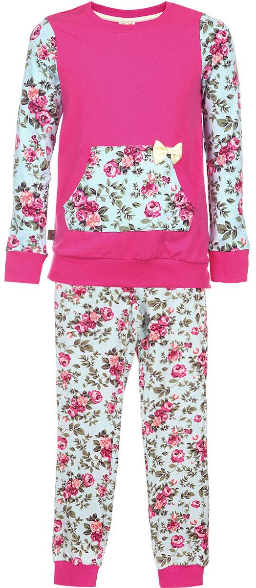 Пижама для девочки KitFox, цвет: розовый, голубой, зеленый. AW15-UAT-GST-152. Размер 116/122AW15-UAT-GST-152Пижама для девочки KitFox, состоящая из футболки с длинным рукавом и брюк, идеально подойдет вашему ребенку. Пижама выполнена из хлопка c добавлением эластана, она очень мягкая и приятная на ощупь, не сковывает движения и позволяет коже дышать, не раздражает даже самую нежную и чувствительную кожу ребенка, обеспечивая ему наибольший комфорт. Футболка с длинными рукавами и круглым вырезом горловиныоформлена оригинальным цветочным принтом и дополнена нашивным карманом-кенгуру, декорированным атласным бантом. Вырез горловины и манжеты на рукавах дополнены трикотажными эластичными резинками.Брюки на талии имеют эластичную резинку и текстильный шнурок, благодаря чему они не сдавливают животик ребенка и не сползают. Модель оформлена нежным цветочным принтом.Пижама станет отличным дополнением к детскому гардеробу. В ней ваш ребенок будет чувствовать себя комфортно и уютно во время сна.