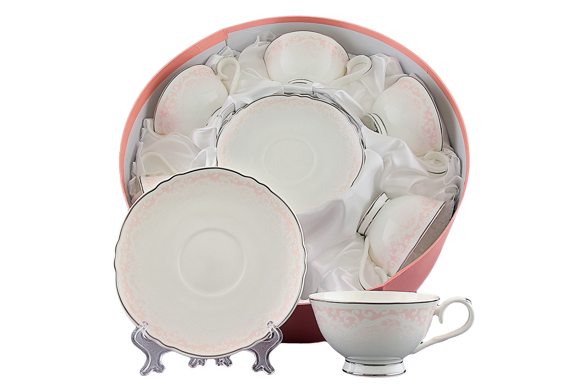 Набор чайный Elan Gallery Розовый шик, 12 предметов530029Чайный набор Elan Gallery Розовый шик состоит из 6 чашек и 6 блюдец. Изделия, выполненные из высококачественной керамики, оформлены изысканным изображением цветочных узоров. Такой набор прекрасно подойдет как для повседневного использования, так и дляпраздников. Чайный набор Elan Gallery Розовый шик - это не только яркий и полезный подарок для родных и близких, это также великолепное дизайнерское решение для вашей кухни или столовой. Не рекомендуется применять абразивные моющие средства.Не использовать в микроволновой печи.Объем чашки: 250 мл. Диаметр чашки (по верхнему краю): 10,8 см. Высота чашки: 6 см.Диаметр блюдца (по верхнему краю): 15,8 см.Высота блюдца: 2 см.