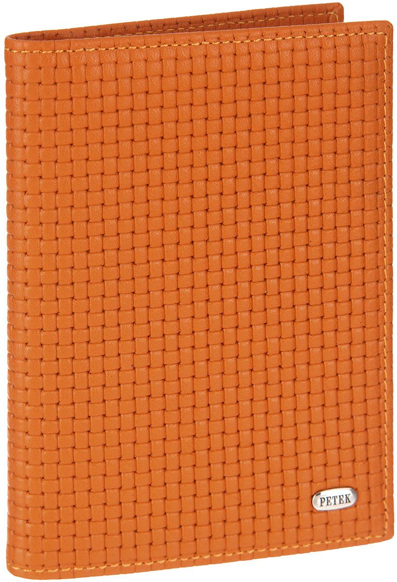 Обложка для автодокументов женская Petek 1855, цвет: ярко-оранжевый. 584.020.89Натуральная кожаОбложка для автодокументов Petek изготовлена из натуральной кожи с оригинальным фактурным тиснением, оформлена металлической фурнитурой с символикой бренда.Изделие раскладывается пополам. Внутри расположены четыре прорезных кармана для кредитных карт, сетчатый кармашек, потайной кармашек, вкладыш для автодокументов, состоящий из шести файлов, один из которых формата А5. Изделие поставляется в фирменной упаковке.Обложка для автодокументов поможет сохранить внешний вид ваших документов и защитить их от повреждений, а также станет стильным аксессуаром.