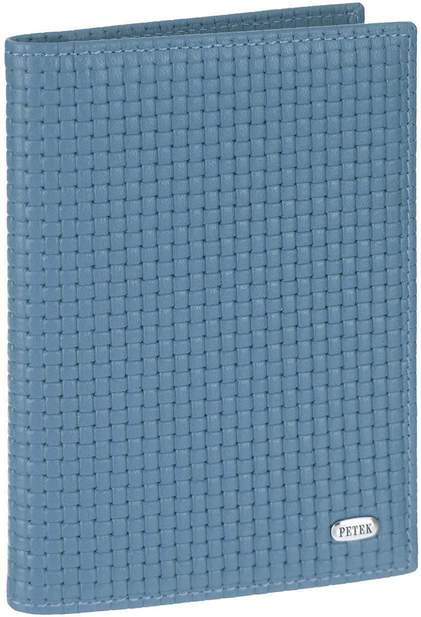 Обложка для автодокументов женская Petek 1855, цвет: голубой. 584.020.22Натуральная кожаОбложка для автодокументов Petek изготовлена из натуральной кожи с оригинальным фактурным тиснением, оформлена металлической фурнитурой с символикой бренда.Изделие раскладывается пополам. Внутри расположены четыре прорезных кармана для кредитных карт, сетчатый кармашек, потайной кармашек, вкладыш для автодокументов, состоящий из шести файлов, один из которых формата А5. Изделие поставляется в фирменной упаковке.Обложка для автодокументов поможет сохранить внешний вид ваших документов и защитить их от повреждений, а также станет стильным аксессуаром.