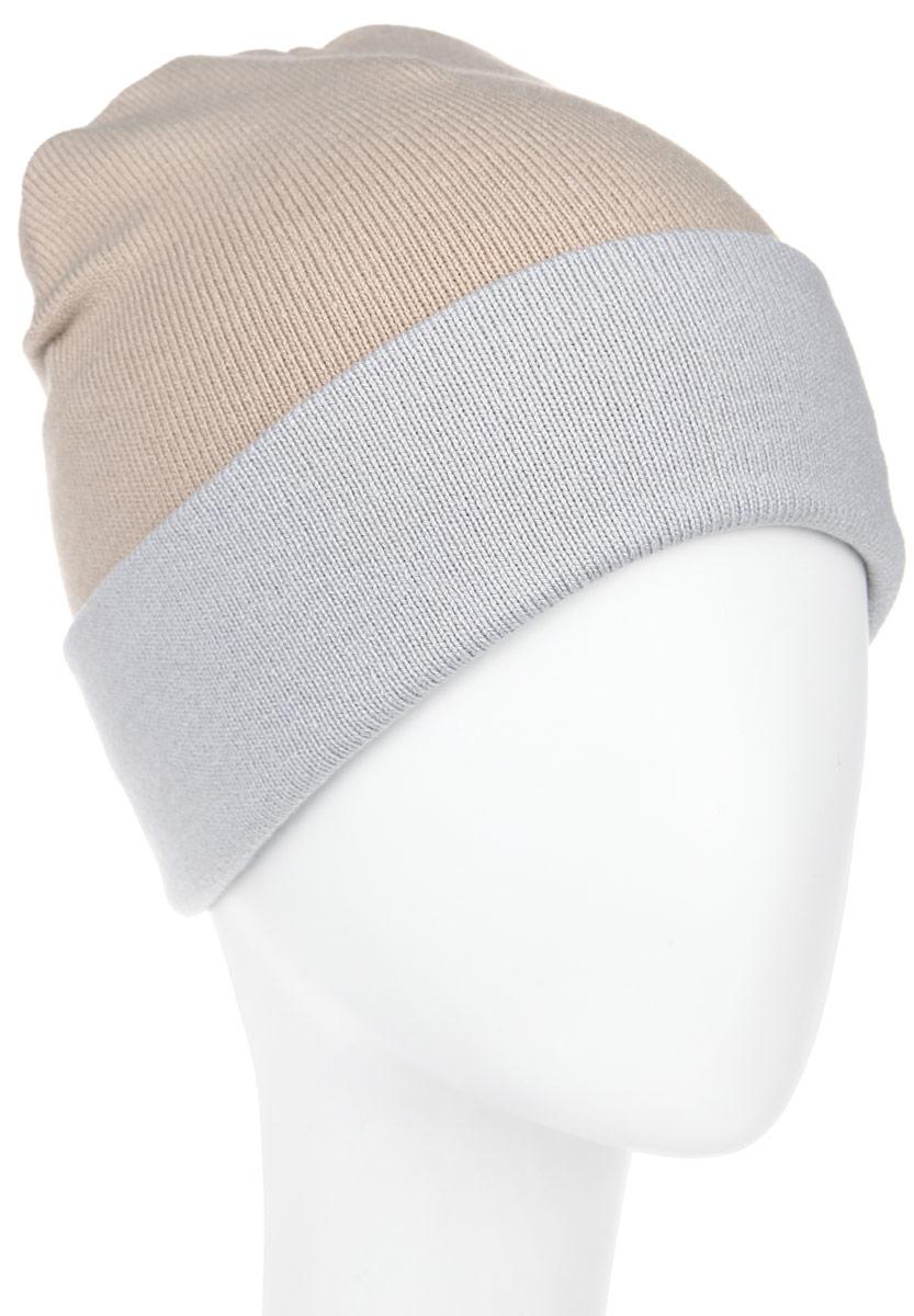 Шапка женская Elfrio, цвет: бежевый, светло-серый. RLH5723. Размер 56/58RLH5723_029/013Удлиненная женская шапка Elfrio отлично дополнит ваш образ в холодную погоду. Сочетание акрила и эластана максимально сохраняет тепло и обеспечивает удобную посадку, невероятную легкость и мягкость. Двухстороннюю двухцветную шапку можно носить как с отворотом, так и без. Стильнаяшапка Elfrio подчеркнет ваш неповторимый стиль и индивидуальность. Такая модель будет актуальна как на спортивных мероприятиях, так и в повседневной жизни. Уважаемые клиенты!Размер, доступный для заказа, является обхватом головы.