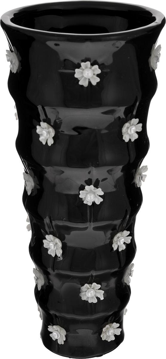 Ваза Sima-land Цветочный дождь, высота 22,5 см866196Ваза Sima-land Цветочный дождь, изготовленная из высококачественной керамики, декорирована объемными пластиковыми элементами в виде цветков со стразами.Дно изделия оснащено противоскользящими накладками.Вазу можно использовать как декоративный элемент, поставить в нее букет прекрасных цветов или декоративных веточек. Нарядная ваза Sima-land Цветочный дождь станет великолепным подарком на любой праздник.Диаметр вазы (по верхнему краю): 10,3 см.Высота вазы: 22,5 см.