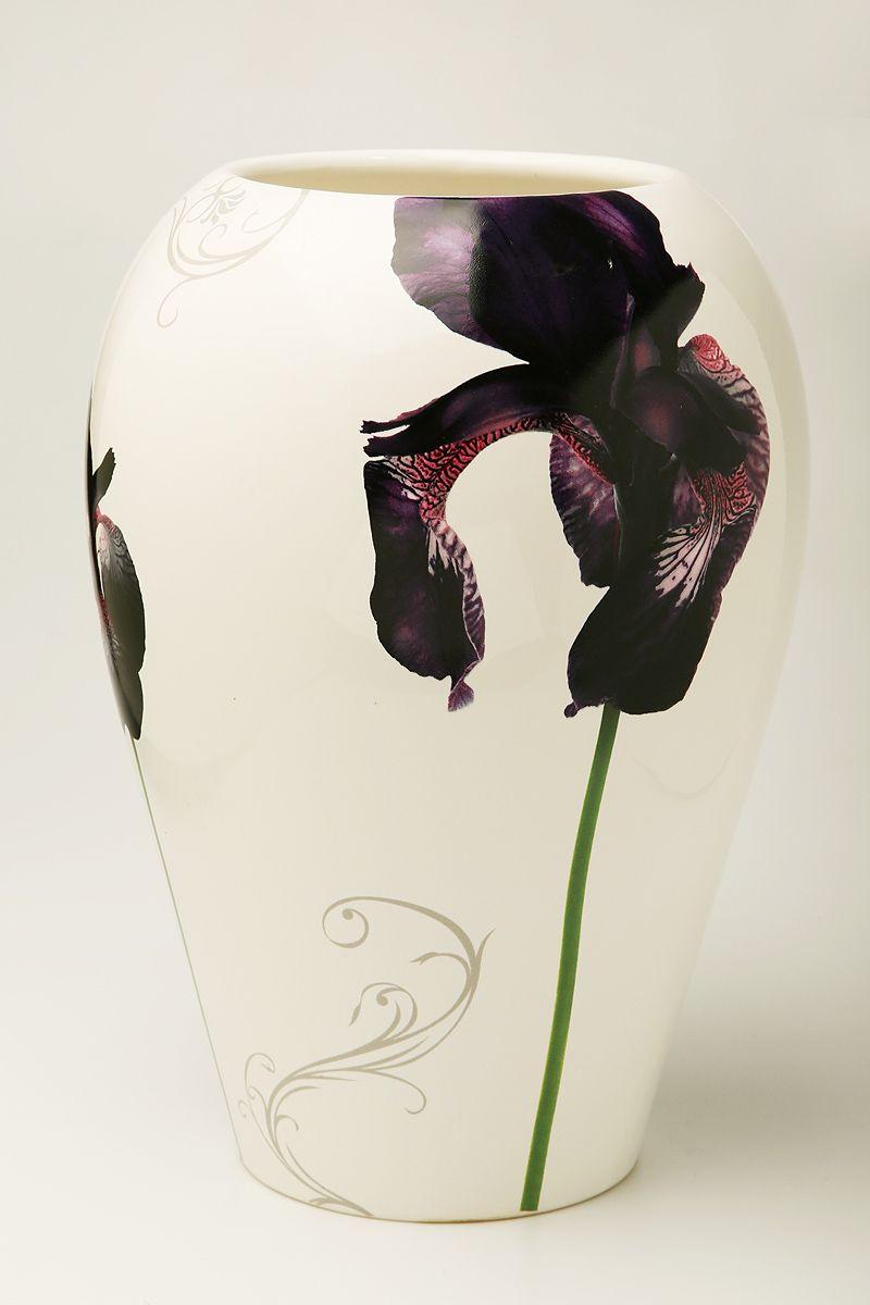 Ваза Nuova R2S Черные ирисы, высота 26 см72104Изящная ваза Nuova R2S Черные ирисы изготовлена из керамики и оформлена цветочным рисунком. Изделие сочетает в себе оригинальный дизайн с максимальной функциональностью.Ваза Nuova R2S Черные ирисы дополнит интерьер офиса или дома и станет желанным подарком для ваших близких.Диаметр вазы: 19 см.Высота вазы: 26 см.