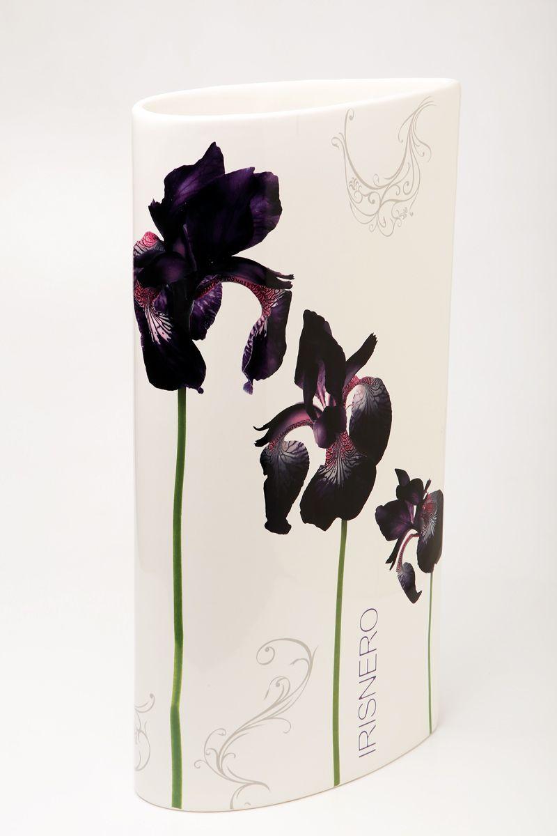 Ваза Ceramiche Viva Черные ирисы, высота 40 см72174Изящная ваза Ceramiche Viva Черные ирисы изготовлена из керамики и оформлена цветочным рисунком. Изделие сочетает в себе оригинальный дизайн с максимальной функциональностью. Ваза Ceramiche Viva Черные ирисы дополнит интерьер офиса или дома и станет желанным подарком для ваших близких.Диаметр вазы: 21 см.Высота вазы: 40 см.