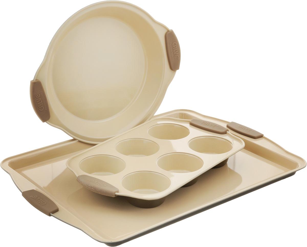 """Набор для выпечки """"Calve"""" состоит из прямоугольного противня, овальной формы для кексов с 6 ячейками и формы для пирога. Формы выполнены из высококачественной углеродистой стали с внутренним керамическим покрытием и силиконовыми ручками. Блюда равномерно нагреваются и пропекаются. Пища в такой форме не пригорает и не прилипает к стенкам, готовые блюда легко вынимаются. Износостойкая конструкция обеспечивает долгий срок службы. Формы можно использовать в духовом шкафу при температуре 200-260°С, а также мыть в посудомоечной машине.  Размер противня: 44 х 30 х 2 см. Размер формы для кексов: 30,5 х 18 х 3,5 см. Диаметр готовых кексов: 7 см. Размер формы для пирога: 28,5 х 23,5 х 3,5 см. Внутренний диаметр формы для пирога: 22 см."""