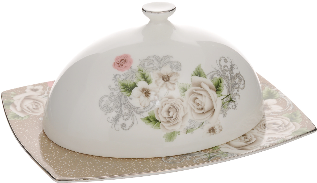 """Масленка Family & Friends """"Florance"""" изготовлена из фарфора, покрытого блестящей глазурью. Изделие представляет собой прямоугольный поднос, на который, благодаря специальным выемкам, устанавливается крышка. Масленка декорирована серебристой эмалью и красивым изображением цветов. Такая масленка станет изысканным украшением стола и порадует вас и ваших гостей оригинальным дизайном и качеством исполнения. Прекрасно подойдет в качестве подарка к любому случаю. Размер подноса: 20 х 15 х 1 см. Размер крышки: 16 х 11 х 8,5 см."""