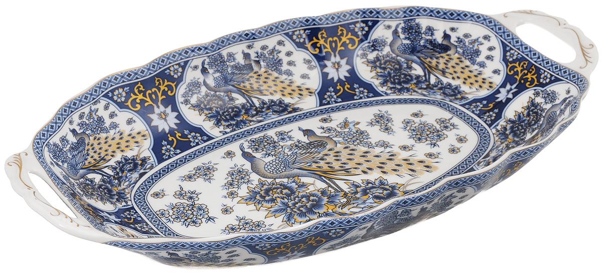 Блюдо для горячего Elan Gallery Синий павлин, 33 х 18,5 см740145Блюдо для горячего Elan Gallery Синий павлин, изготовленное из керамики, станет украшением вашего праздничного стола. Изделие подходит для подачи горячего или шашлыка. В такой посуде можно приготовить блюдо и, не перекладывая на другую тарелку, подать его стол. Благодаря двум ручками его удобно переносить.Красочность оформления придется по вкусу тем, кто предпочитает утонченность и изящность. Не рекомендуется применять абразивные моющие средства.Не использовать в микроволновой печи.Объем блюда: 900 мл.Размер блюда (с учетом ручек): 33 х 18,5 х 5,2 см.