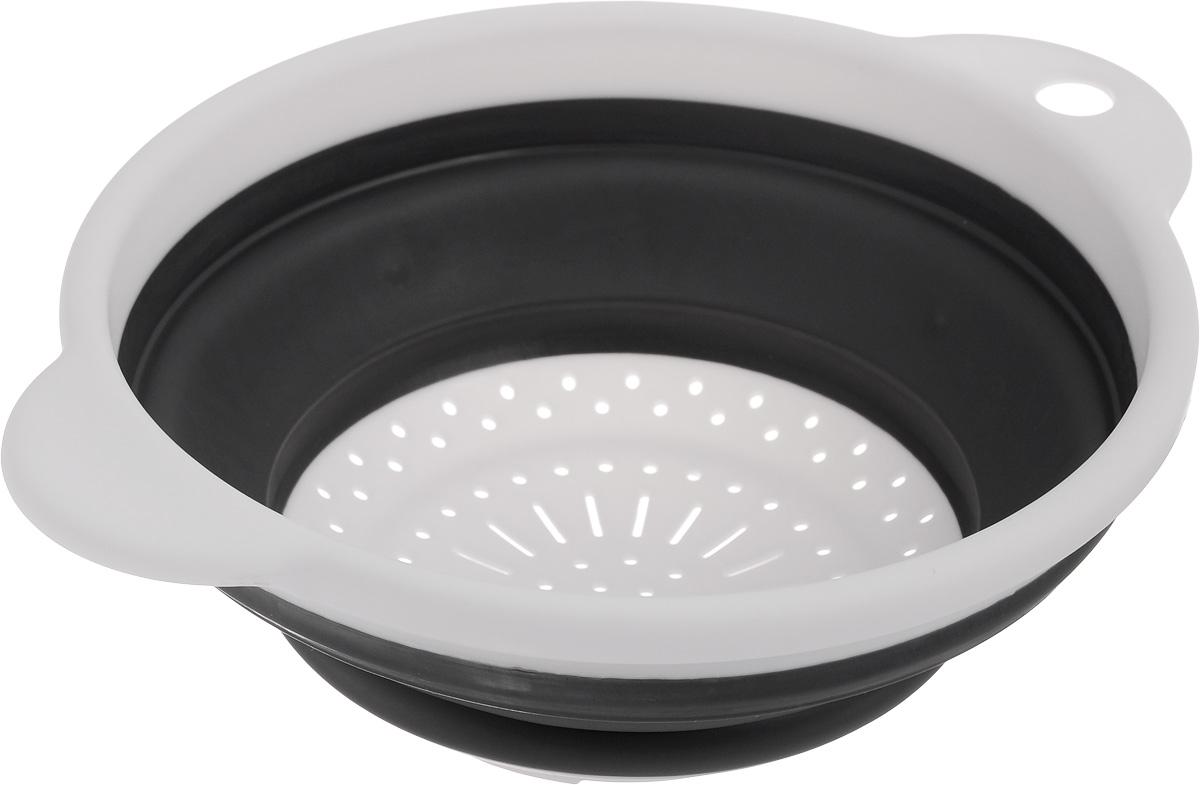 Дуршлаг Идея, складной, цвет: белый, черный. CLD-02CLD-02_белый,черныйДуршлаг складной Идея, изготовленный из высококачественного пищевого пластика и силикона, станет полезным приобретением для вашей кухни. Он идеально подходит для процеживания, ополаскивания макарон, овощей, фруктов. Нельзя мыть и сушить в посудомоечной машине.Внутренний диаметр: 18 см. Размер (в разложенном виде): 23 х 20 х 9 см.Размер (в сложенном виде): 23 х 20 х 3 см.