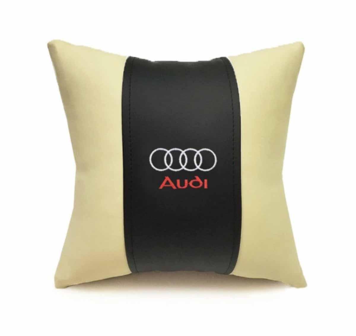 Подушка декоративная Auto Premium Audi, цвет: черный, бежевый37040Подушка в машину с вышивкой автологотипа Auto Premium Audi - отличное дополнение для салона вашего авто. Мягкая подушка, изготовленная из матовой экокожи, будет удобна пассажиру. Она долго не перестанет радовать вас своим видом. Оптимальный размер подушки (30 х 30 см) не загромождает салон автомобиля.