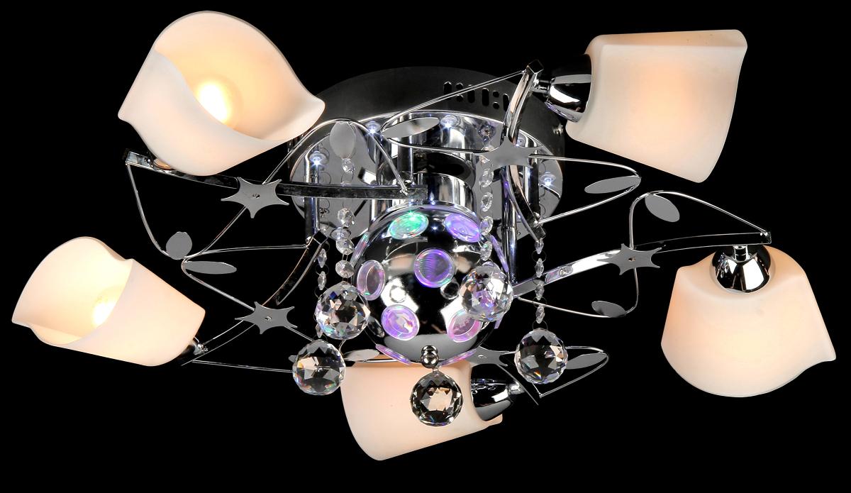 Люстра Natali Kovaltseva, 5 x E14, 40W. 10413/5С10413/5С CHROMEЛюстра Natali Kovaltseva, выполненная в изысканном стиле, станет украшением вашей комнаты и красиво дополнит интерьер. Изделие крепится к потолку. Такая люстра отлично подойдет для освещения кабинета, столовой, спальни или гостиной. Люстра выполнена из металла с хромированной поверхностью, снабжена галогеновыми светодиодами с 2 режимами свечения и 5 плафонами изящной формы из матового стекла. Изделие дополнено подвесками и фигурками. В комплекте поставляется пульт дистанционного управления. В коллекциях Natali Kovaltseva представлены разные стили - от классики до хайтека. Дизайн и технологическая составляющая продукции разрабатывается в R&D центре компании, который находится в г. Дюссельдорф, Германия. При производстве продукции используются высококачественные и эксклюзивные материалы: хрусталь ASFOR, муранское стекло, перламутр, 24-каратное золото, бронза. Производство светильников соответствует стандарту системы менеджмента качества ISO 9001-2000. На всю продукцию ТМ Natali Kovaltseva распространяется гарантия.