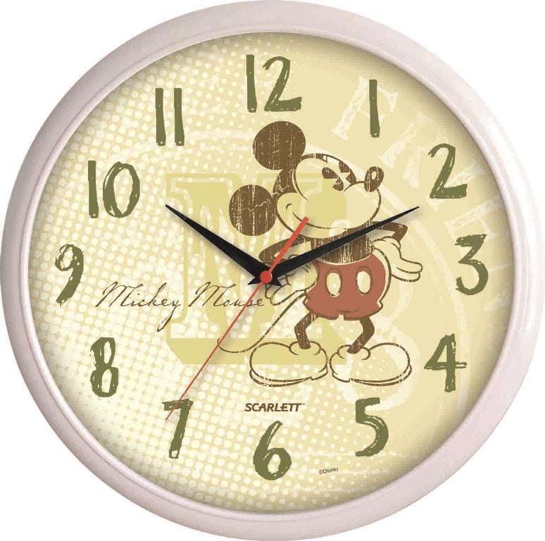 """Настенные кварцевые часы """"Scarlett"""", изготовленные из  пластика, прекрасно впишутся в интерьер  вашего дома. Круглые часы имеют три стрелки: часовую,  минутную и секундную, циферблат защищен прозрачным  пластиком.  Часы работают от 1 батарейки типа АА напряжением 1,5 В  (батарейка в комплект не входит).   Диаметр часов: 29 см."""