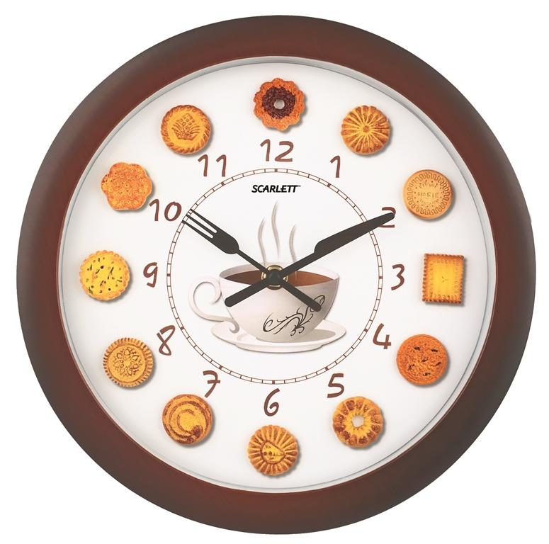 Часы настенные Scarlett, диаметр 27,5 см. SC - 25QASC - 25QAНастенные кварцевые часы Scarlett в классическом дизайне,изготовленные из пластика, прекрасно впишутся в интерьервашей кухни. Круглые часы имеют две стрелки: часовую иминутную. Стрелки оформлены в виде вилки и ноже. Циферблатзащищен прозрачным пластиком.Часы работают от 1 батарейки типа АА напряжением 1,5 В(батарейка в комплект не входит). Диаметр часов: 27,5 см.