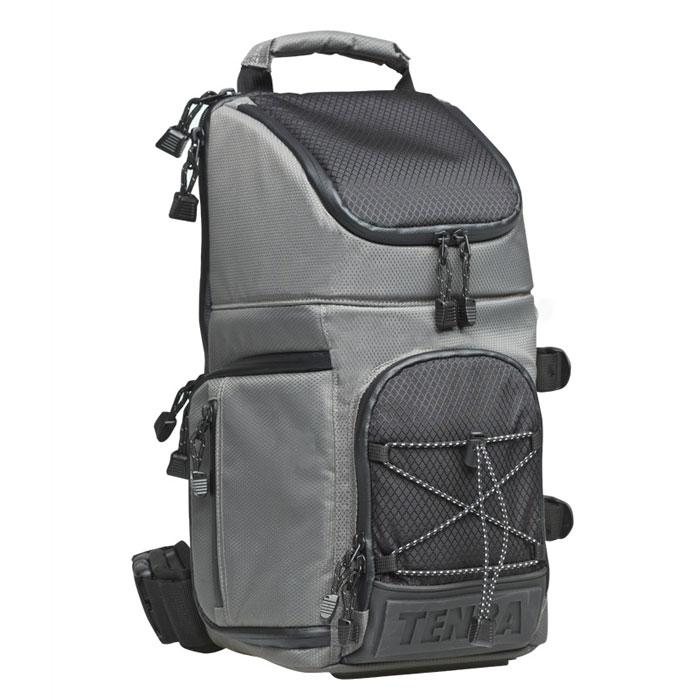 Tenba Shootout Sling Small, Silver Black рюкзак для фотооборудованияEP-011001_оранжевыйВместительный рюкзак Tenba Shootout Sling Small с эксклюзивным дизайном защитит ваше оборудование от неблагоприятных внешних условий, а благодаря небольшому весу, он будет хорошим помощником в путешествиях. Вмещает в себя 1-2 камеры, 3-4 объектива, вспышку и аксессуары; камеру с установленным телеобъективом до 300 мм f/2.8, также предусмотрена возможность крепления штатива или монопода.