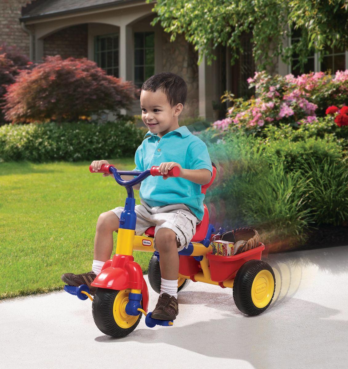 Удобное сиденье, 3 положения, открепляющаяся спинка, ремни безопасности, ограничитель (в дополнение к ремням безопасности, для 1-го этапа),   держатель для бутылочки, корзина сзади, тент от солнца. Колёса из прорезиненного пластика. Прекрасный яркий. Велосипед трехколесный Little Tikes 3 в 1   предназначен для самых маленьких гонщиков. По мере взросления ребенка велосипед также будет менять свою модификацию. Когда малыш сможет   самостоятельно управлять велосипедом, возможно убрать родительскую ручку, снять бортик безопасности и Little Tikes 3 в 1 превратится в обычный   трехколесный велосипед.  Характеристики модели:  - для детей от 9 месяцев до 3 лет; - мягкие колеса EVA с протектором, изготовлены из PP (полипропилен) и EVA (этиленвинилацетат); - максимальный допустимый вес ребенка 23 кг; - устойчивый и безопасный; - сиденье со спинкой пластиковое; - материал пластик; - управление рулем; - корзинка для игрушек; - толстая прочная рама; - родительская ручка; - подвижный тент от солнца; - пятиточечные ремни безопасности; - подножка для ног; - нескользящие педали и ручки руля; - держатель для бутылочки; - максимальная нагрузка на корзину 2,3 кг; - размеры велосипеда 93 х 48 х 93 см.      Какой велосипед выбрать? Статья OZON Гид