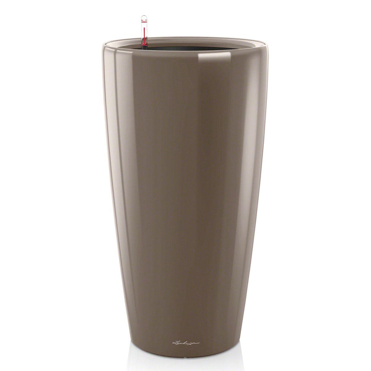 Кашпо Lechuza Rondo, с системой автополива, цвет: серо-коричневый, диаметр 40 см15744Кашпо Lechuza Rondo, изготовленное извысококачественного пластика, идеальное решение для тех,кто регулярно забывает поливать комнатные растения.Стильный дизайн позволит украсить растениями офис, кафеили любое другое помещение.Кашпо Lechuza Rondo с системой автополиваупростит уход за вашими цветами и поможет растениямполучать то количество влаги, которое им необходимо вданный момент времени. В набор входит: кашпо, внутренний горшок, индикатор уровняводы, вал подачи воды, субстрат растений в качестведренажного слоя, резервуар для воды. Внутренний горшок, оснащенный выдвижными ручками,обеспечивает: - легкую переноску даже высоких растений; - легкую смену растений; - можно также просто убрать растения на зиму; - винт в днище позволяет стечь излишней дождевой воденаружу. Кашпо Lechuza Rondo украсит любой интерьер истанет замечательным подарком для ваших родных иблизких.