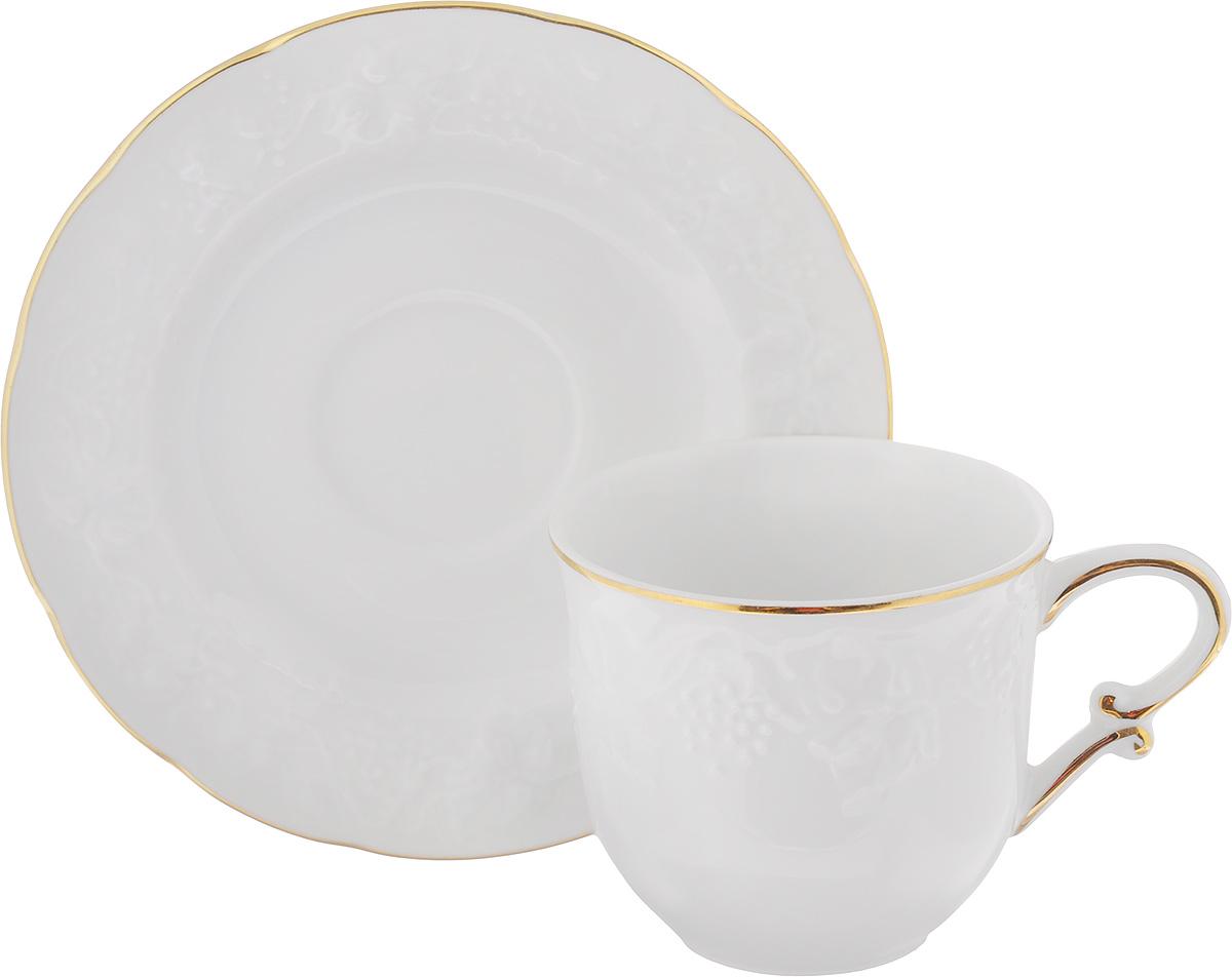 Кофейная пара La Rose Des Sables Vendanges, цвет: белый, золотистый, 2 предмета6935101009Кофейная пара La Rose Des Sables Vendanges, изготовленная из высококачественного фарфора, состоит из чашки и блюдца. Изделия, оформленные рельефным изображением винограда, имеют изысканный внешний вид.Кофейная пара La Rose Des Sables Vendanges украсит ваш кухонный стол, а также станет замечательным подарком к любому празднику.Объем чашки: 100 мл.Диаметр чашки (по верхнему краю): 6,5 см.Высота чашки: 6 см. Диаметр блюдца (по верхнему краю): 12 см. Высота блюдца: 1,6 см.