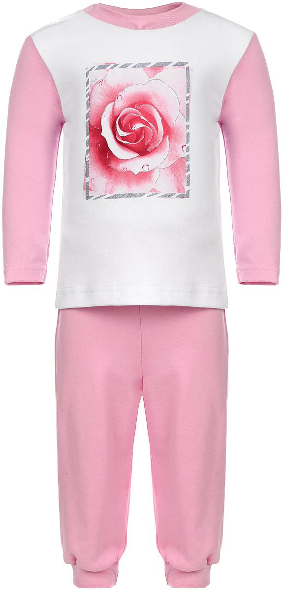 Пижама для девочки КотМарКот, цвет: розовый, белый. 16163. Размер 80, 9-12 месяцев16163Удобная пижама для девочки КотМарКот, состоящая из футболки с длинным рукавом и брюк, идеально подойдет вашему ребенку. Пижама выполнена из натурального хлопка, она необычайно мягкая и приятная на ощупь, не сковывает движения и позволяет коже дышать, не раздражает даже самую нежную и чувствительную кожу ребенка, обеспечивая ему наибольший комфорт. Футболка с длинными рукавами и круглым вырезом горловины оформлена изображением изящной розочки в блестящей рамке. Футболка на плече застегивается на металлические кнопки, что позволяет с легкостью переодеть ребёнка. Вырез горловины дополнен эластичной резинкой. Брюки прямого кроя на поясе имеют широкую эластичную резинку, благодаря чему они не сдавливают животик ребенка и не сползают. Низ брючин дополнен широкими эластичными манжетами.Пижама станет отличным дополнением к гардеробу маленькой принцессы, в ней ваш ребенок будет чувствовать себя комфортно и уютно во время сна.