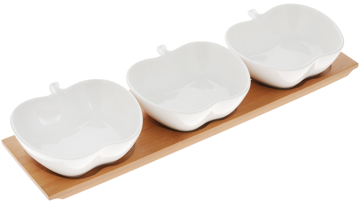 Блюдо сервировочное Elan Gallery Яблоко, на подставке, 120 мл, 3 шт540060Сервировочные блюда Elan Gallery Яблоко изготовлены из высококачественной керамики. Изделия выполнены в виде яблок и идеально подойдет для красивой сервировки различных блюд, таких как икра, конфеты, мед и варенье. В комплекте подставка, выполненная из бамбука.Оригинальные сервировочные блюда станутизысканным украшением вашего праздничногостола. Объем: 120 мл.Размер блюд: 10,8 х 10,7 х 3,5 см.Размер подставки: 33,5 х 8,5 х 1,5 см.