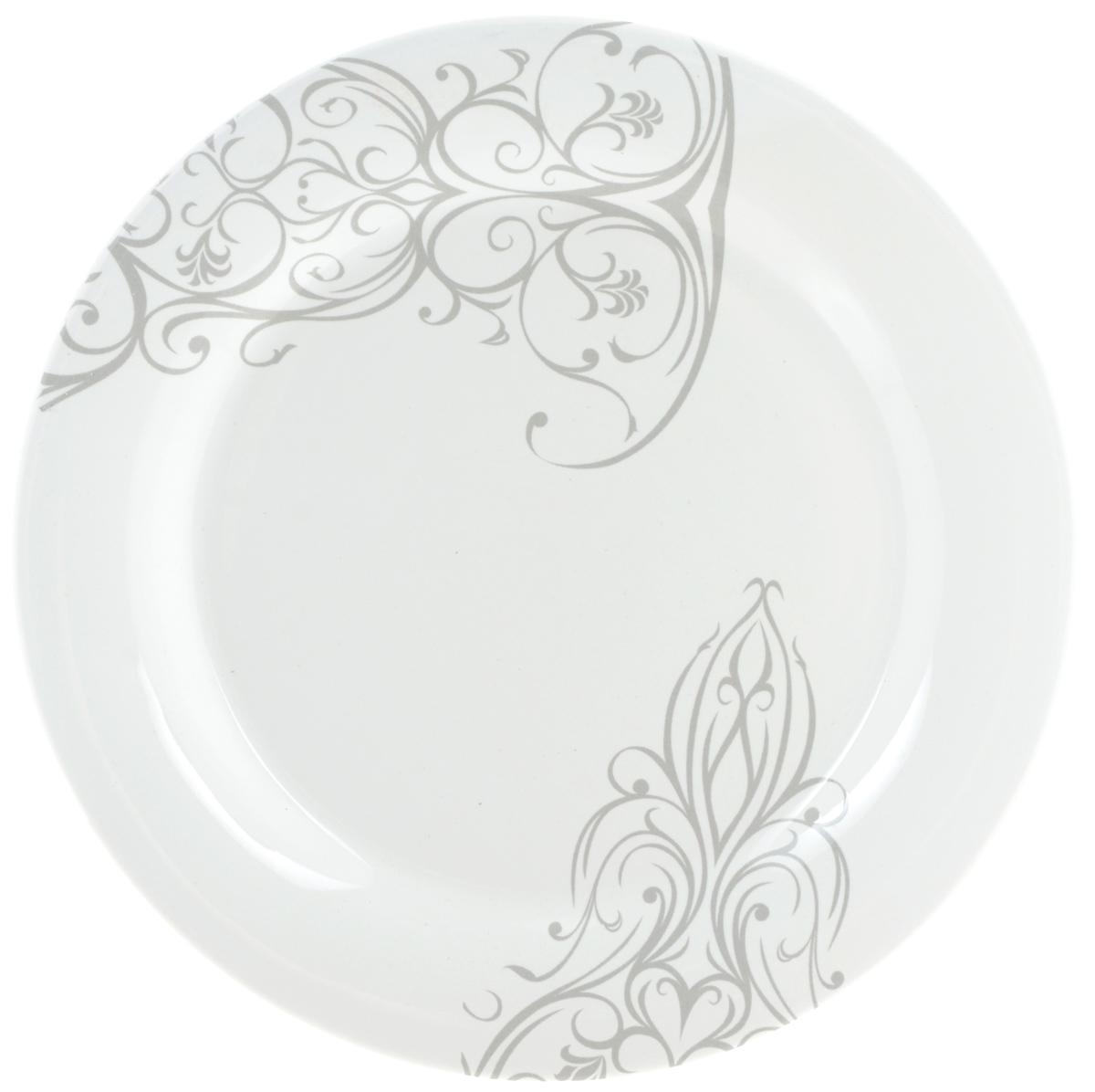"""Десертная тарелка Ceramiche Viva """"Черный ирис"""" изготовлена из высококачественной керамики, покрытой слоем сверкающей глазури. Изделие декорировано красивыми узорами. Такая тарелка отлично подойдет в качестве блюда для закусок и нарезок, а также для подачи различных десертов. Тарелка прекрасно дополнит сервировку стола и порадует вас оригинальным дизайном. Допускается мытье в посудомоечной машине, а также использование для разогрева блюд в СВЧ-печи. Диаметр тарелки: 20 см. Высота стенки: 2 см."""