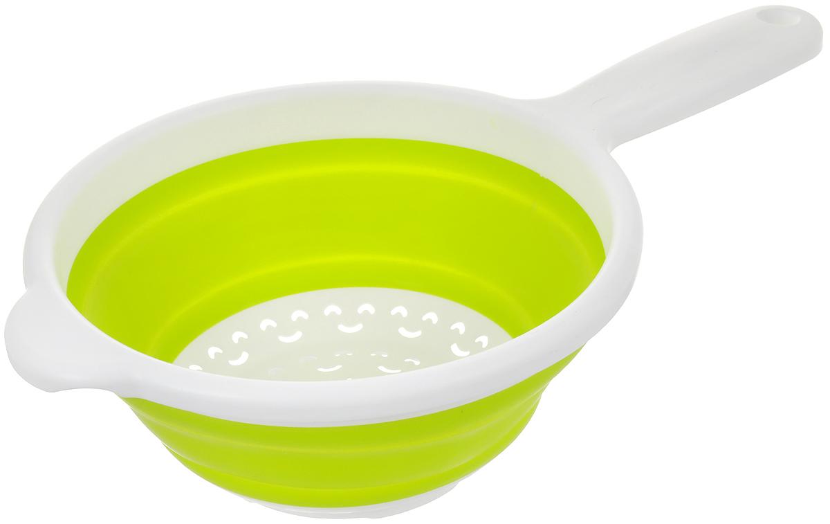 Дуршлаг Calve, складной, цвет: белый, салатовый, диаметр 20,5 смCL-4592Дуршлаг Calve, изготовленный из высококачественного пластика и силикона, станет полезным приобретением для вашей кухни. Изделие оснащено ручкой для комфортного использования. Дуршлаг предназначен для отделения жидкости от твёрдых веществ, например, после варки макаронных изделий, круп, картофеля. Также он используется для мытья и промывания ягод, грибов, мелких фруктов и овощей.Дуршлаг компактно складывается, что делает его удобным для хранения.Можно мыть в посудомоечной машине.Внутренний диаметр: 18,2 см.Размер (в разложенном виде): 34 х 20,5 х 9 см.Размер (в сложенном виде): 34 х 20,5 х 3 см.
