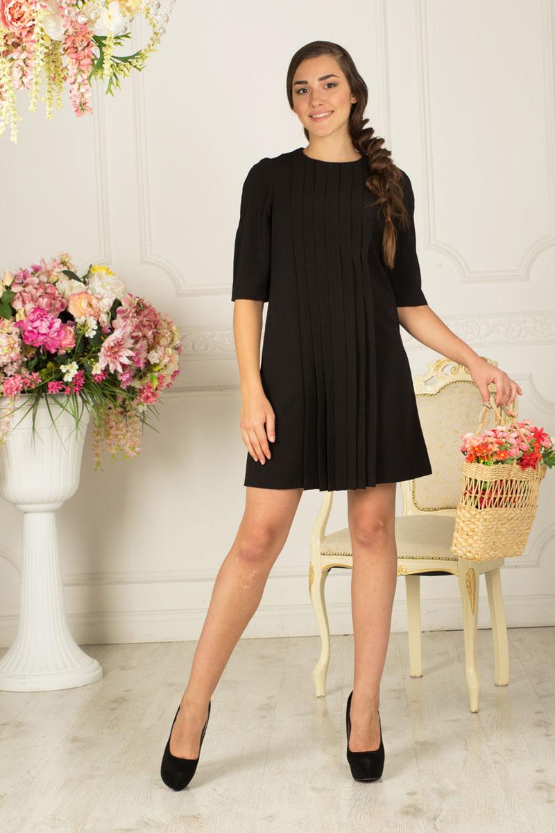 Платье Lautus, цвет: черный. 743. Размер 46743Элегантное платье Lautus выполнено из высококачественного эластичного полиэстера с добавлением вискозы. Оно обеспечит вам комфорт и удобство при носке.Модель А-силуэта с рукавами 1/2 и круглым вырезом горловины спереди декорирована сборками по всей длине изделия. Изделие застегивается на спинке на скрытую молнию. Модель прекрасно сочетается с различными аксессуарами. Это модное и удобное платье станет превосходным дополнением к вашему гардеробу, оно подарит вам удобство и поможет вам подчеркнуть свой вкус и неповторимый стиль. Отлично подойдет как для повседневного использования, так и для вечеринки.