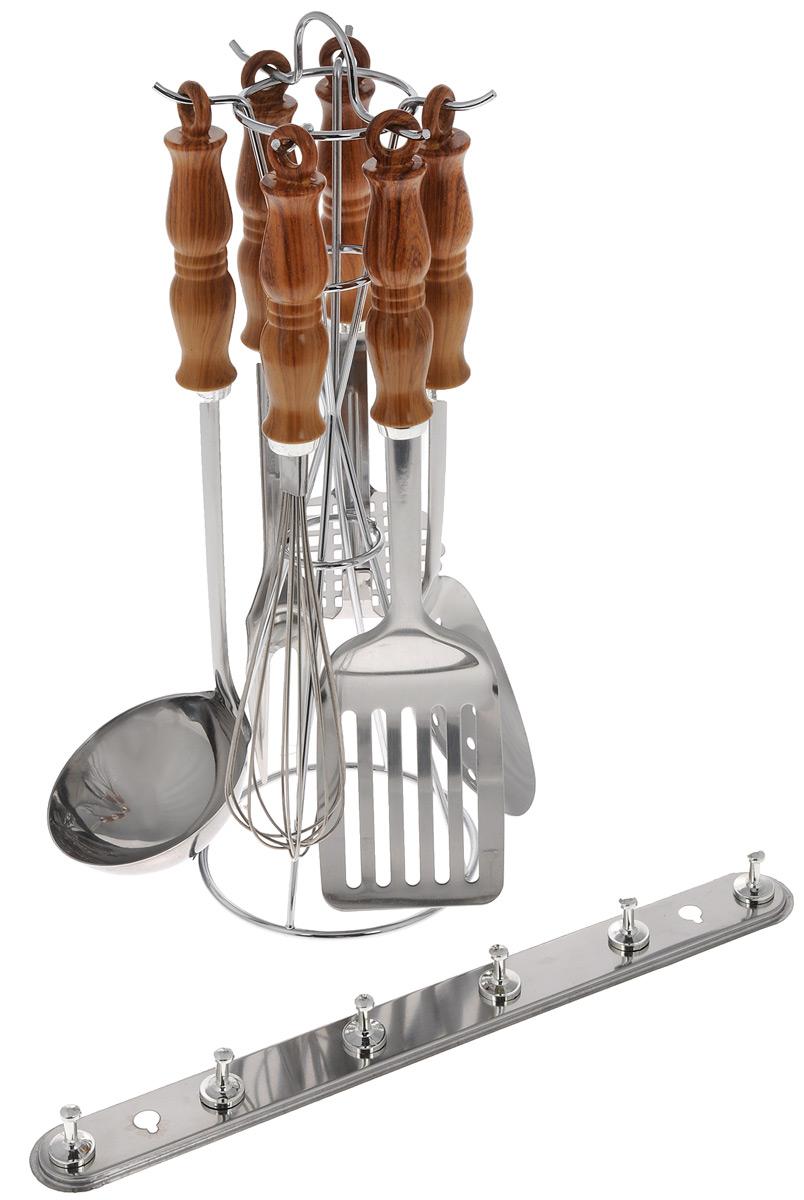 Набор кухонных принадлежностей Mayer & Boch, 8 предметов. 34453445Набор Mayer & Boch состоит из картофелемялки, венчика, шумовки, вилки, половника, лопатки с прорезями, настенного крепления и подставки. Приборы изготовлены из высококачественной нержавеющей стали. Приборы не окисляются со временем и не портят вкус ваших кулинарных шедевров. Рукоятки выполнены из термопластика под дерево.Данный набор придаст вашей кухне элегантность, подчеркнет индивидуальный дизайн и превратит приготовление еды в настоящее удовольствие.Этот профессиональный набор очень удобен в использовании и имеет стильную подставку, декорированную под дерево, которая позволяет хранить приборы в одном месте. Длина приборов: 24-34 см. Размер настенного крепления: 33 х 2,5 х 3,5 см. Размер подставки: 13 х 13 х 37 см.