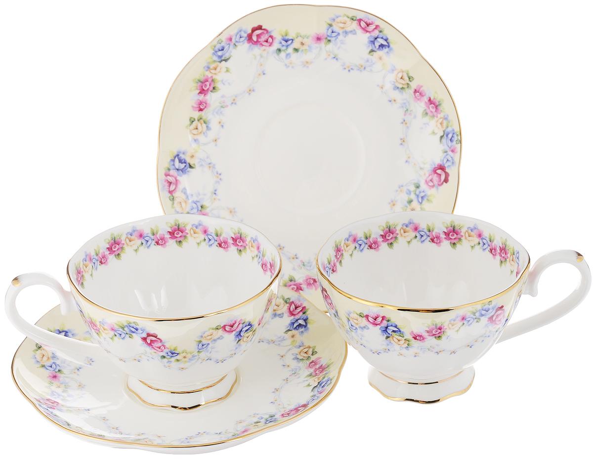 Набор чайных пар Elan Gallery Гирлянда из роз, 4 предмета530037Набор чайных пар Elan Gallery Гирлянда из роз состоит из 2 чашек и 2 блюдец. Предметы набора выполнены из высококачественной керамики и оформлены изящным изображением цветочных узоров. Яркий дизайн, несомненно, придется вам по вкусу.Набор чайных пар Elan Gallery Гирлянда из роз украсит ваш кухонный стол, а также станет замечательным подарком к любому празднику. Объем чашки: 250 мл.Диаметр чашки (по верхнему краю): 10 см.Высота чашки: 6,5 см.Диаметр блюдца: 16 см.Высота блюдца: 2 см.