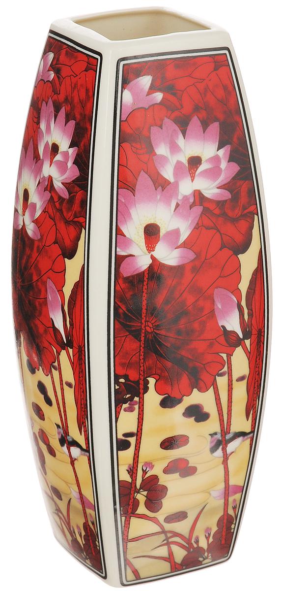 Ваза Elan Gallery Цветок лотоса, высота 21 см501909Декоративная ваза Elan Gallery Цветок лотоса украсит ваш интерьер и будет прекрасным подарком для ваших близких! Изделие выполнено из высококачественного фарфора и оформлено цветочным рисунком. Оригинальный дизайн наполнит ваш дом праздничным настроением. Изделие имеет подарочную упаковку, поэтому станет желанным подарком для ваших близких!Размер по верхнему краю: 5,2 см х 5,2 см.Размер дна: 5,3 см х 5,3 см.Высота вазы: 21 см.