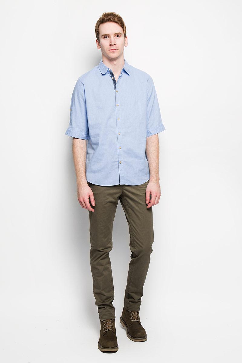 Рубашка мужская Sela, цвет: светло-голубой. Hs-212/670-6123. Размер 39 (44)Hs-212/670-6123Стильная мужская рубашка Sela, выполненная из хлопка и льна, мягкая и приятная на ощупь, не сковывает движения и позволяет коже дышать, обеспечивая комфорт. Модель с отложным воротником и короткими рукавами застегивается на пластиковые пуговицы по всей длине. Низ рукава обработан манжетами, которые застегиваются на пуговицы. Эта модная и удобная рубашка послужит отличным дополнением к вашему гардеробу.
