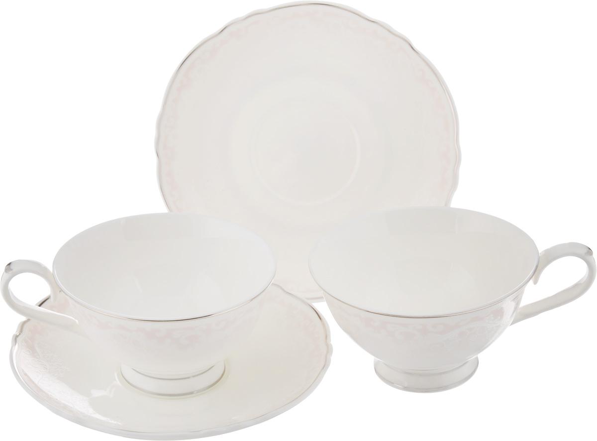 Набор чайный Elan Gallery Розовый шик, 4 предмета530028Чайный набор Elan Gallery Розовый шик состоит из 2 чашек и 2 блюдец,изготовленных из высококачественной керамики. Предметы набора декорированы серебристой окантовкой инежными узорами.Чайный набор Elan Gallery Розовый шик украсит ваш кухонный стол, а такжестанет замечательным подарком друзьям и близким.Набор упакован в подарочную коробку с атласной подложкой. Не рекомендуется применять абразивные моющие средства. Не использовать в микроволновой печи.Объем чашки: 220 мл.Диаметр чашки по верхнему краю: 10,5 см.Высота чашки: 6 см.Диаметр блюдца: 15,5 см.
