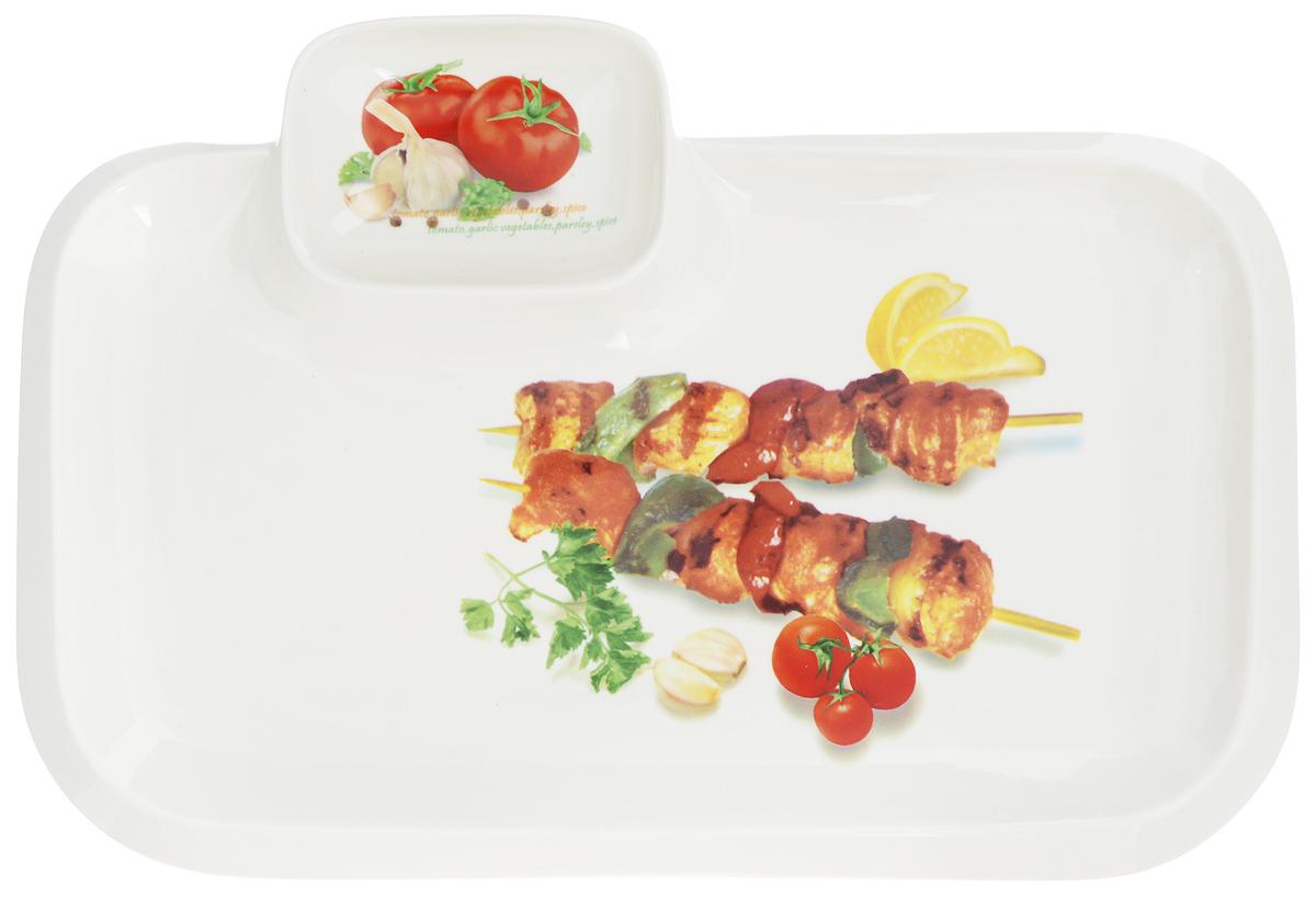 Блюдо для шашлыка Elan Gallery Шашлык, с соусницей, 35 х 24 см101191Сервировочное блюдо Elan Gallery Шашлык, изготовленное из керамики, идеально подойдет для подачи шашлыка на стол, а отделение для соуса поможет избежать использования дополнительной посуды. Это блюдо можно использовать для сервировки не только шашлыка, но и овощей, креветок, хлеба и других продуктов. Оно станет отличным дополнением к вашему кухонному инвентарю и подчеркнет прекрасный вкус хозяйки.Не рекомендуется применять абразивные моющие средства. Не использовать в микроволновой печи. Размер блюда (по верхнему краю): 35 х 24 см.Размер соусницы: 10 х 7,5 см.