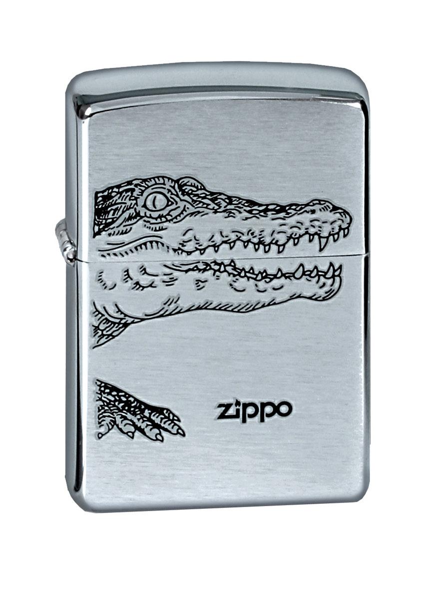 Зажигалка Zippo Brushed Chrome. Alligator200 ALLIGATORБренд Zippo известен практически всем любителям табака, а также тем, кто интересуется простыми и изящными вещами. Компания была основана еще в 1932 году. За более чем 80-летнюю историю карманная зажигалка Zippo не претерпела больших изменений: как и прежде, она остается удивительно простым и в тоже время гениальны произведением инженерной мысли. Каждая зажигалка производится в Брэдфорде, штат Пенсильвания, США. Каждая зажигалка имеет клеймо на дне (Буква, находящаяся слева от надписи Zippo, обозначает месяц изготовления: А-январь/В-февраль/С-март/D-апрель/Е-май/F-июнь/G-июль/Н-август/I-сентябрь/J-октябрь/К-ноябрь/L-декабрь). Ветроустойчива - легко приводится в действие на улице. Благодаря надежной металлической конструкции имеет пожизненную гарантию!- Рекомендуем заправлять только первоклассным топливом Zippo - Серия Brushed Chrome - Изображение аллигатора на фронтальной поверхности - Упакована в коробку созданную из экологически чистых материалов - Пожизненная гарантия - Рекомендуем заправлять только первоклассным топливом Zippo