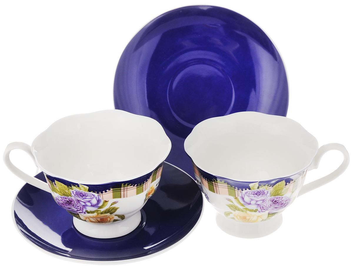 Набор чайный Loraine Розы, цвет: синий, 4 предмета23002_синийЧайный набор Loraine состоит из двух чашек и двух блюдец. Изделия выполнены из высококачественного костяного фарфора, чашки оформлены красивым цветочным рисунком, а блюдца однотонные.Такой набор красиво дополнит сервировку стола к чаепитию. Благодаря изысканному дизайну и качеству исполнения, такой набор станет замечательным подарком для ваших друзей и близких.Набор упакован в подарочную коробку в форме сердца, задрапированную белой атласной тканью.Объем чашки: 200 мл.Диаметр чашки (по верхнему краю): 9,5 см.Высота чашки: 6,5 см.Диаметр блюдца: 14 см.