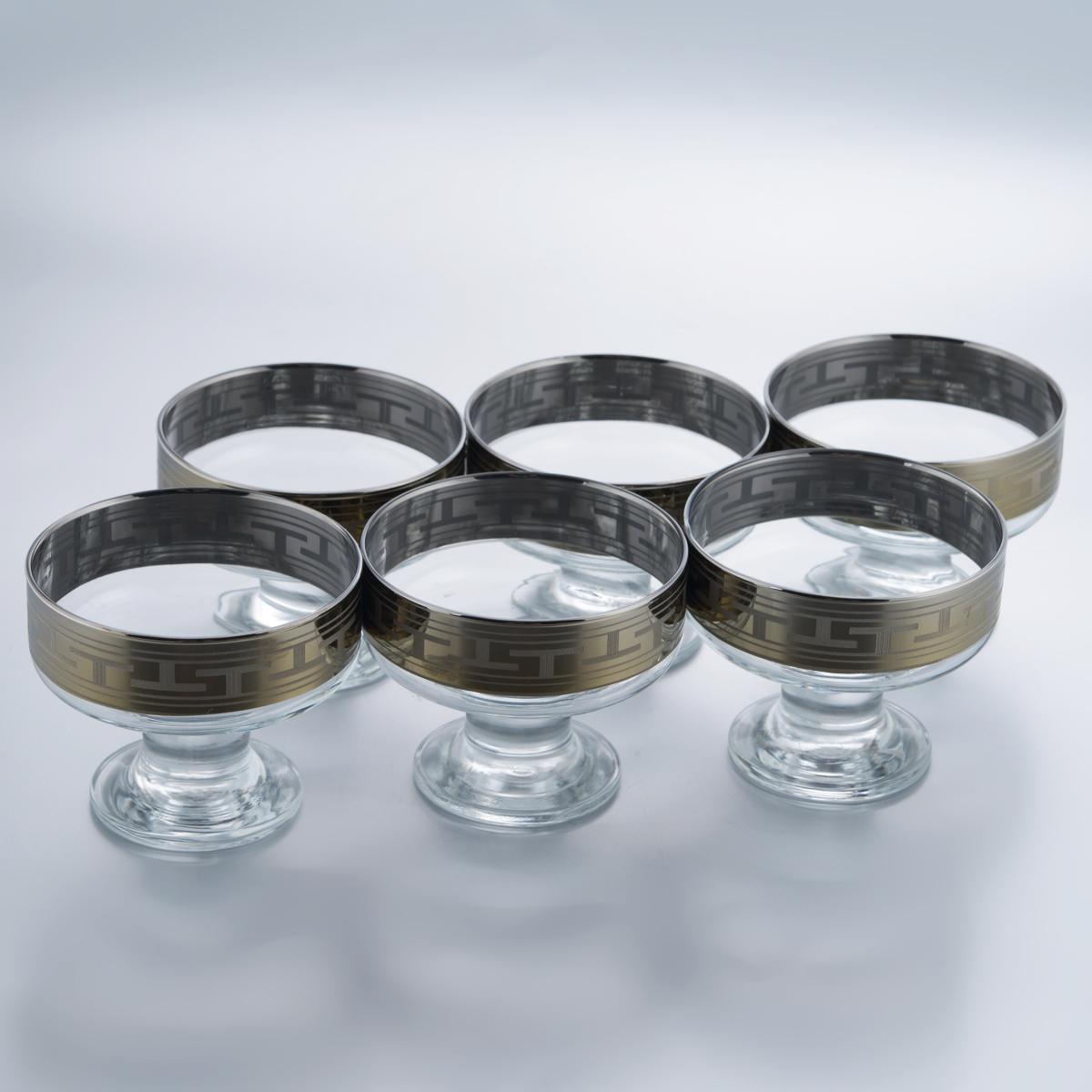 Набор креманок для мороженого Гусь-Хрустальный Греческий узор, 250 мл, 6 штGE01-1016Набор Гусь-Хрустальный Греческий узор состоит из 6 креманок, изготовленных из высококачественного натрий-кальций-силикатного стекла. Изделия оформлены красивым зеркальным покрытием и широкой окантовкой с греческим узором. Креманки прекрасно подойдут для подачи десертов и мороженого. Такой набор прекрасно дополнит праздничный стол и станет желанным подарком в любом доме. Разрешается мыть в посудомоечной машине. Диаметр креманки (по верхнему краю): 9,8 см. Высота креманки: 8 см. Диаметр основания креманки: 6,4 см.