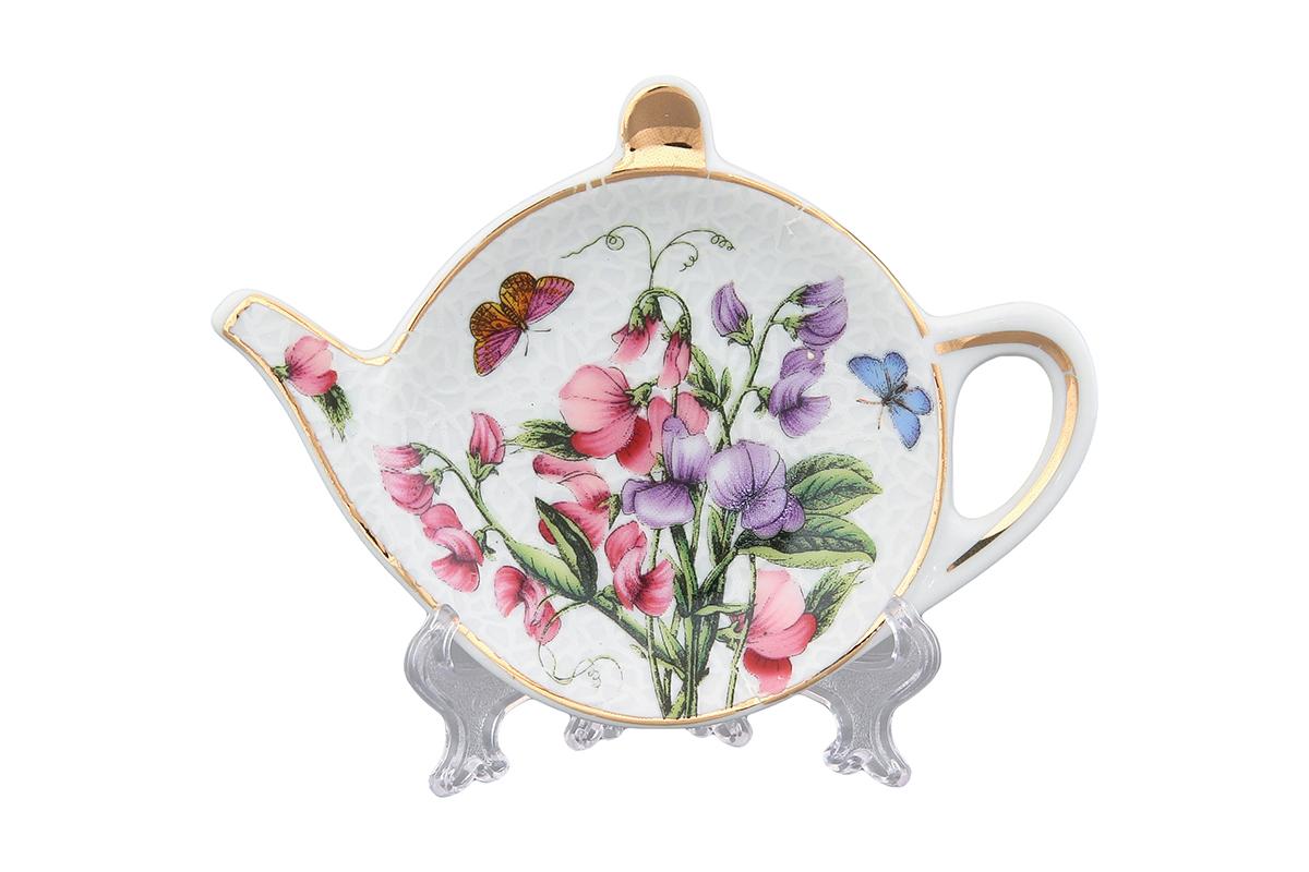 Подставка под чайный пакетик Elan Gallery Душистый цветокYM116029-4Подставка для чайных пакетиков, выполненная в форме чайничка, изготовлена из высококачественной керамики. Подставка придется по вкусу любой хозяйке, так как кухонный стол всегда останется чистым, без нежелательных разводов от чайных пакетиков.