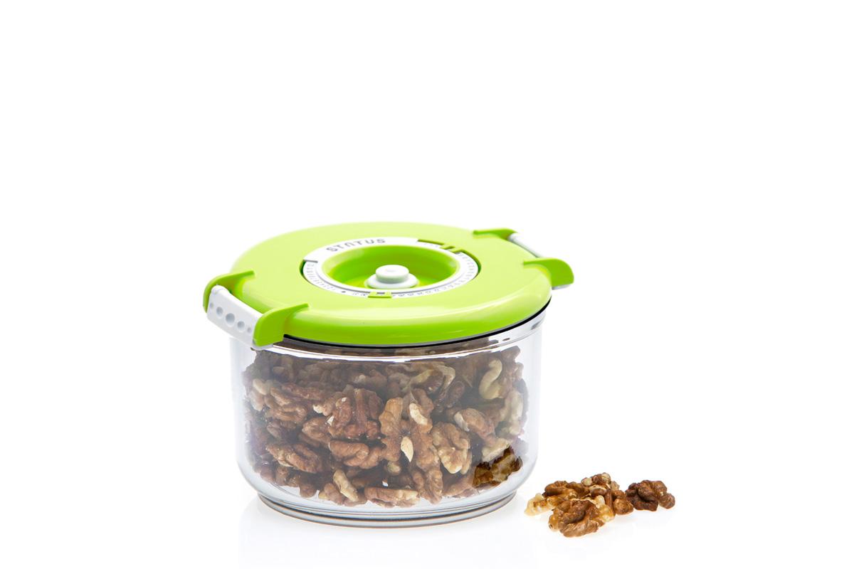 Контейнер вакуумный Status, цвет: прозрачный, зеленый, 0,75 лVAC-RD-075 GreenВакуумный контейнер Status рекомендован для хранения следующих продуктов: фрукты, овощи, хлеб, колбасы, сыры, сладости, соусы, супы. Благодаря использованию вакуумных контейнеров, продукты не подвергаются внешнему воздействию и срок хранения значительно увеличивается. Продуктысохраняют свои вкусовые качества и аромат, а запахи в холодильнике не перемешиваются. Контейнер изготовлен из прочного хрустально-прозрачного тритана. На крышке - индикатор даты (месяц, число). Допускается замораживание (до -21 °C), мойка контейнера в посудомоечной машине, разогрев в СВЧ (без крышки). Объем контейнера: 0,75 л. Размер: 13 х 10 см.