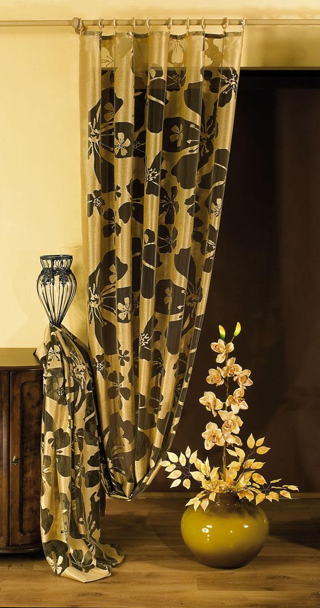 Штора Wisan, на ленте, цвет: коричневый, золотистый, высота 250 см. 59255925Штора Wisan, выполненная из легкого полиэстера, станет великолепным украшением окна в спальне или гостиной. Изделие дополнено красивым цветочным рисунком по всей поверхности полотна. Качественный материал, изысканная цветовая гамма и оригинальный дизайн привлекут к себе внимание и позволят шторе органично вписаться в интерьер помещения. Штора оснащена шторной лентой под зажимы для крепления на карниз.